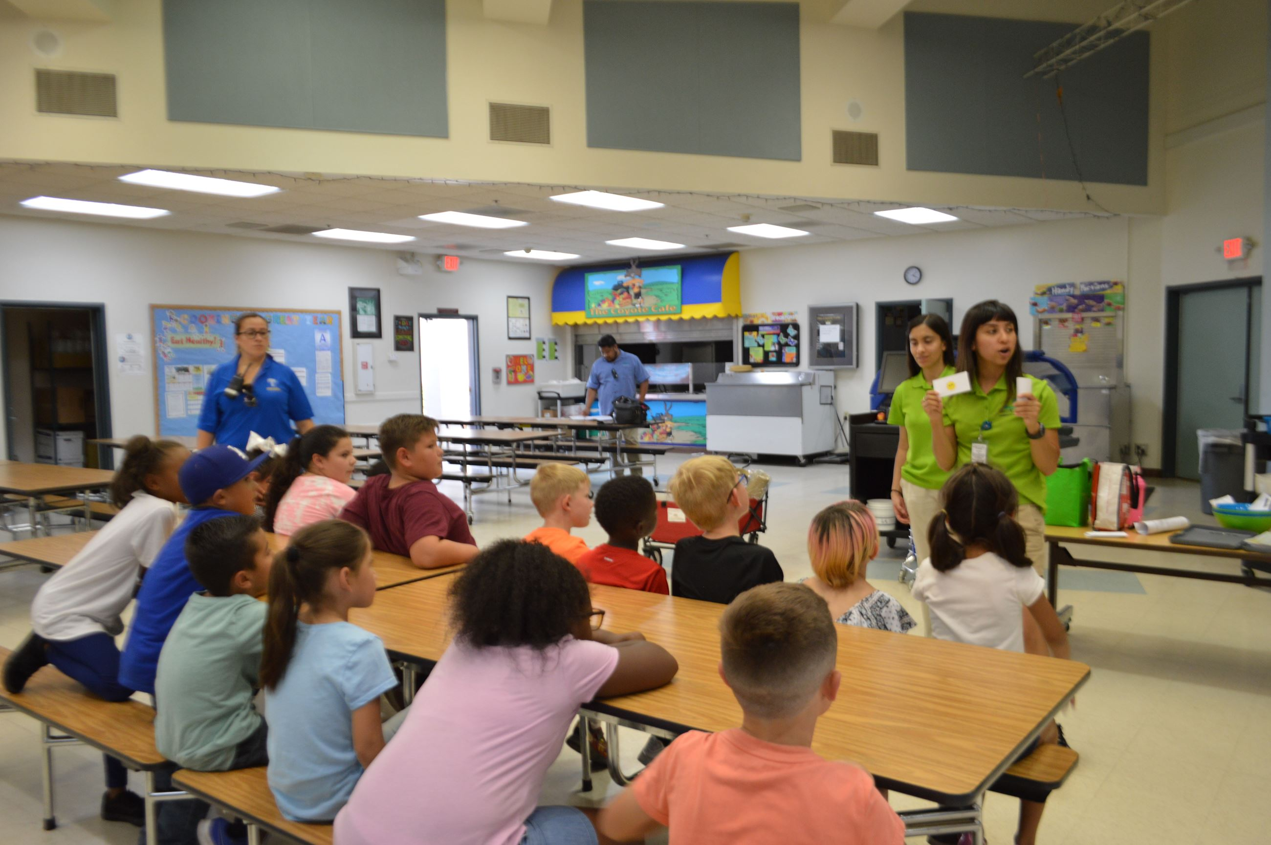 Children in cafeteria watching Healthy Fontana presentation